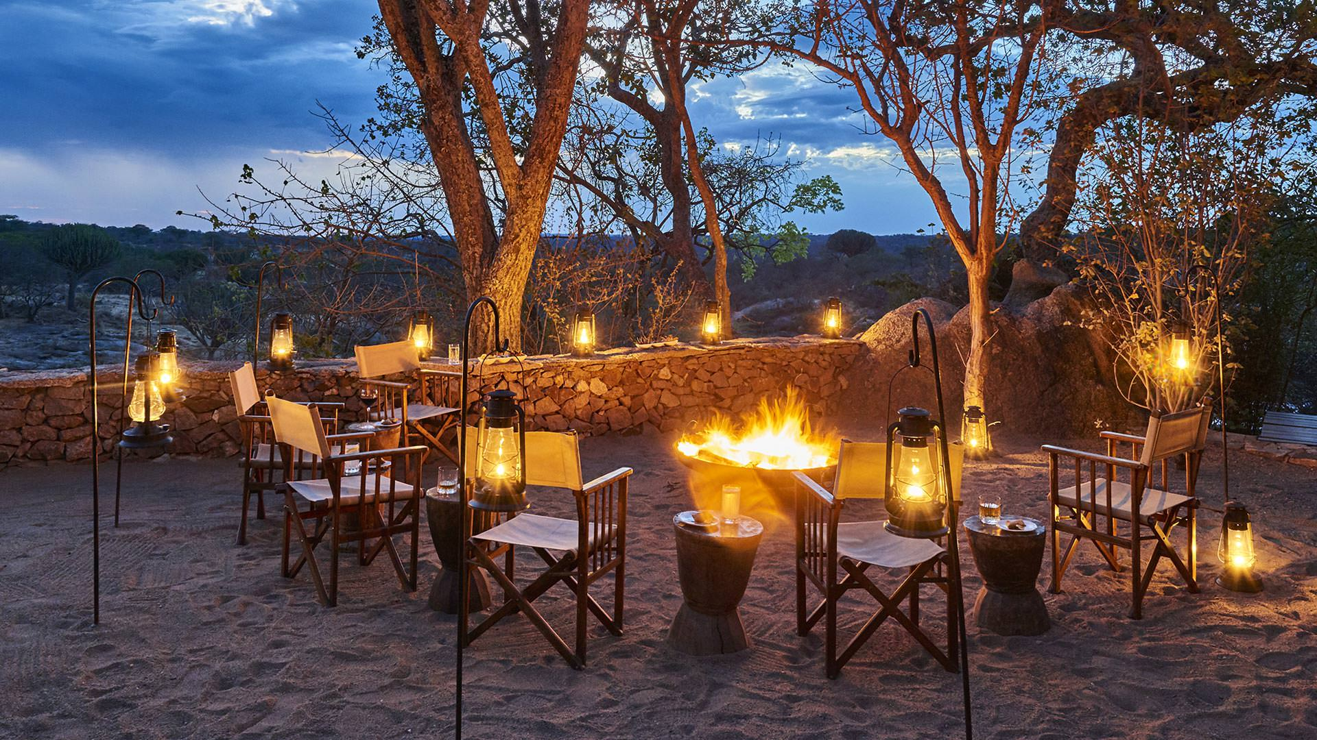 Drinks by the fireside at Mwiba Lodge