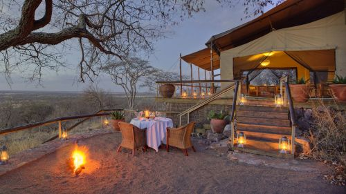 Dinner by the fireside at Subeti Camp