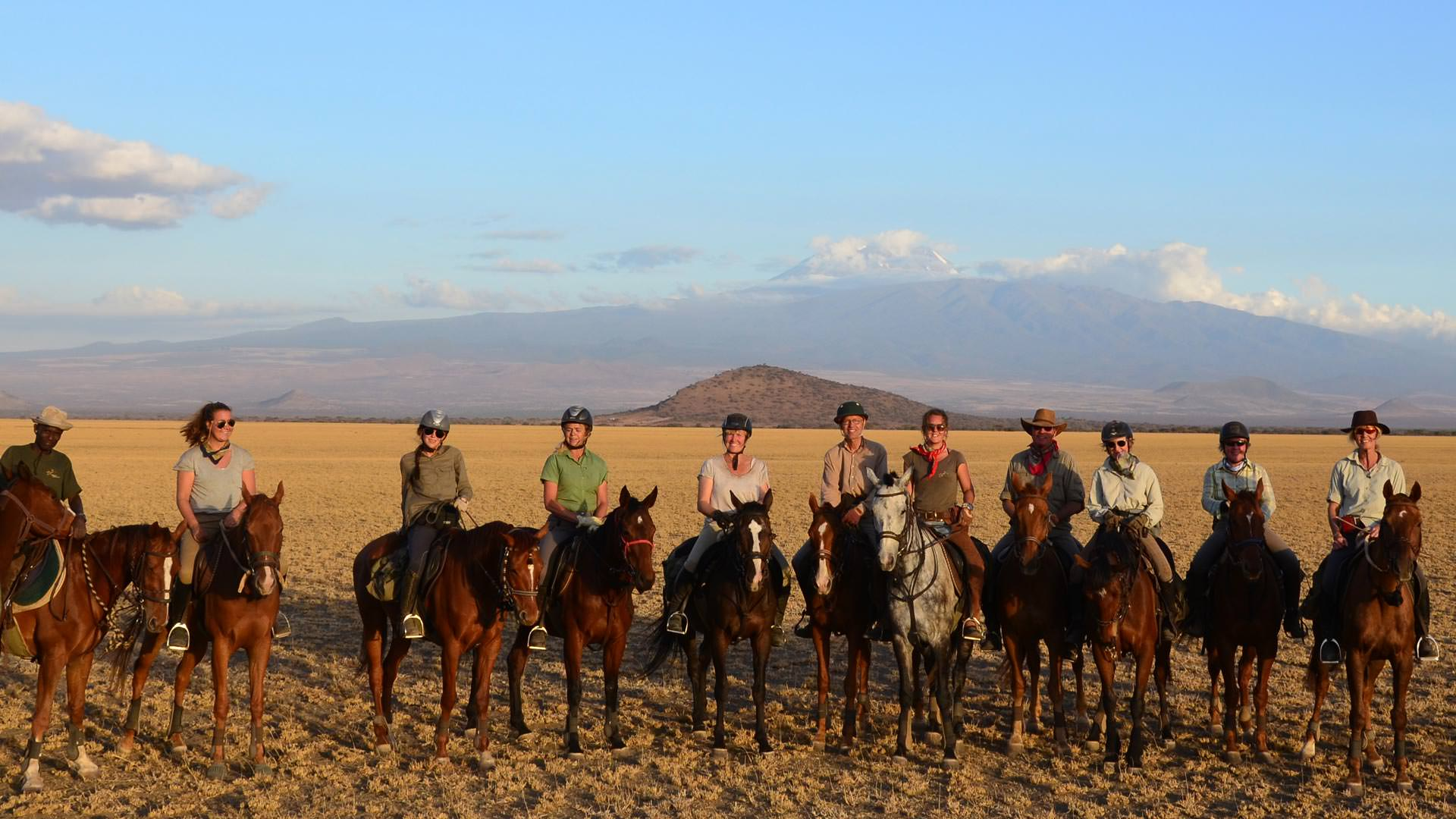Lining up the horses in front of Kilimanjaro